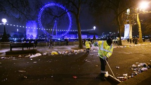 Workers begin the clean-up effort on the Embankment in central London.