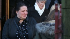 Up to 1,000 people gathered to mourn the family.