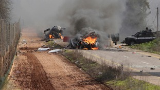 Burning vehicles are seen near the village of Ghajar on Israel's border with Lebanon January 28, 2015.