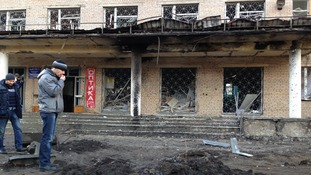 At least three people were killed when a shell landed outside this hospital in Donetsk.