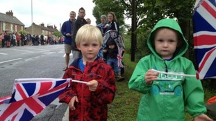 William and Henry wave their flags