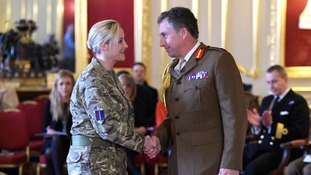 hief of the General Staff, General Sir Nicholas Carter shakes the hand of Squadron Leader Charlotte Joanne Thompson-Edgar.