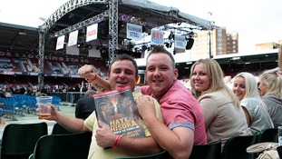 Fans wait in the crowd ahead of the David Haye and Derek Chisora fight at Upton Park, London.