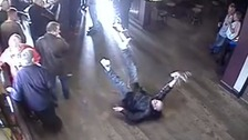 Hilarious CCTV video shows punter fall to pub floor like famous 'Del Boy' scene.