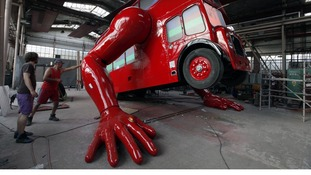 Robot made from a London bus does press-ups