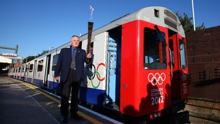London Underground employee John Light and the Olympic flame