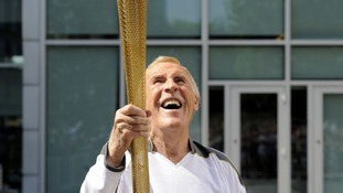 Sir Bruce Forsyth carries Olympic Flame