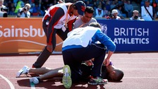 Medics tending to Gemili on the track