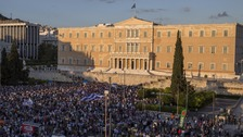 Thousands join pro-euro rally in Athens as PM agrees to key proposals