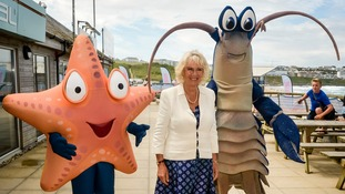 The Duchess of Cornwall with 'Larry the Lobster' and 'Sally the Starfish'.
