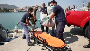 A body is carried onto a stretcher after the boats sunk.