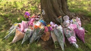 Flowers laid near to where Amber Peat's body was found