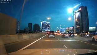 A green fireball thought to be a meteor lights up the sky above the Thai capital Bangkok