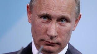 Putin: Downing of Russian warplane a 'stab in the back'.