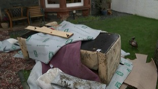 Flood damaged furniture has been removed from the house
