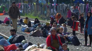 Migrants wait at the Greek-Macedonia border