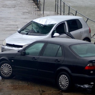 The damage done to the cars in Mousehole