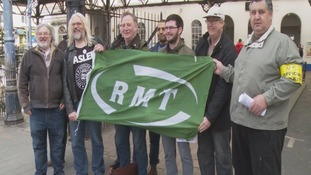 TRain conductors holding RMT banner